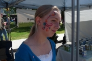 Rayne Bryan proudly displays her face paint; Photo, Mona Mattei